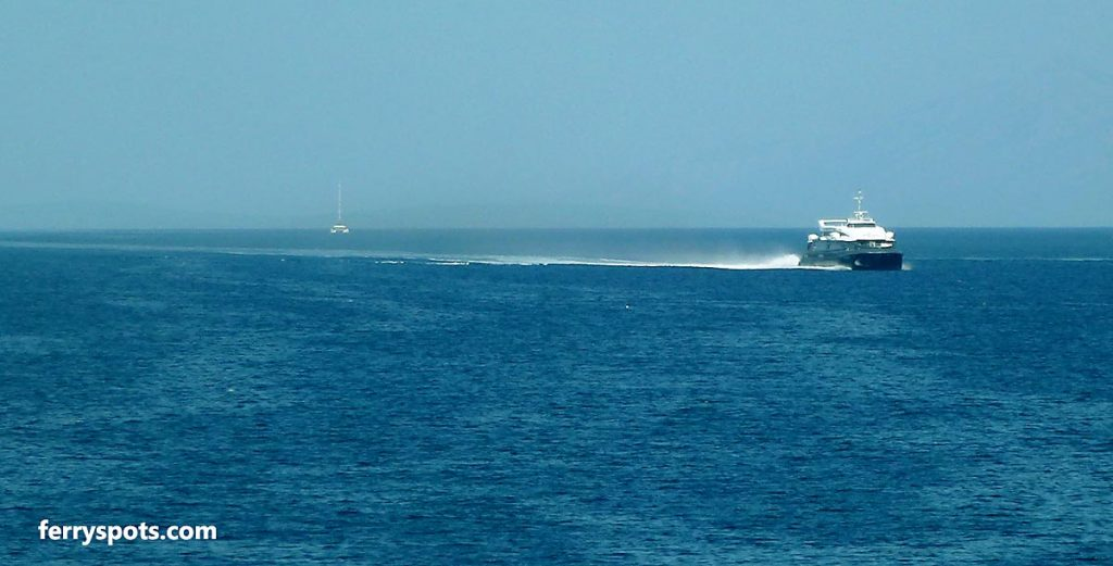 Fast passenger catamaran ferry crossing a large body of water
